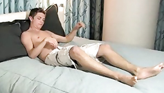 Pretty young and handsome twink boy shoved hand in pants and rubbing his dick