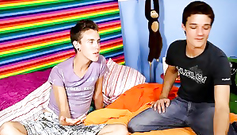 A gay boy is sucking candy and his boyfriend is sucking his cock