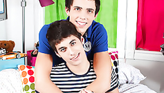 Sweet young brunette twink boys are posing on the bed