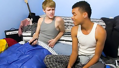 Afro-American young gay is having fuck white twink