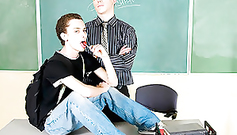 Gay are got naughty and posing to the camera on teacher's desk